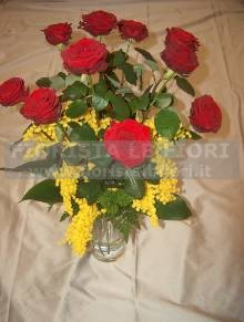 Bouquet of  red roses long-stemmed and mimosa flowers Women´s Day red roses and mimosa